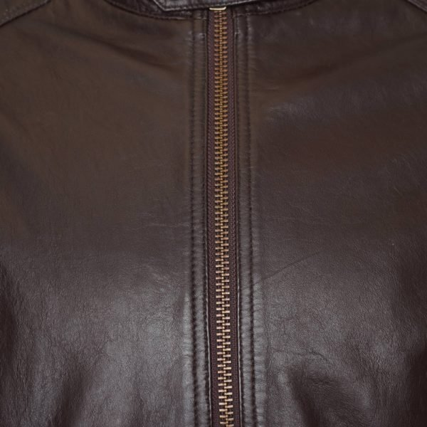 This image shows a Barneys Originals men's brown real leather jacket. This image focuses on the chest of the jacket.