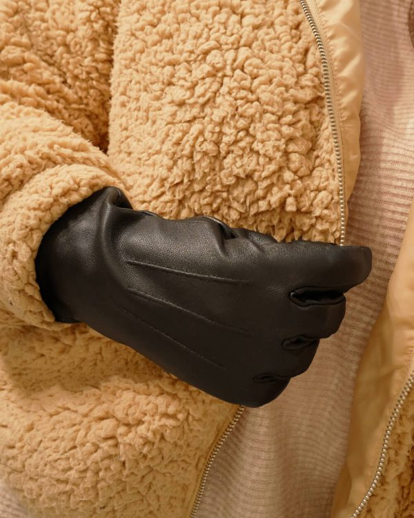 Image displays the black leather thinsulate gloves against a teddy bear faux jacket.
