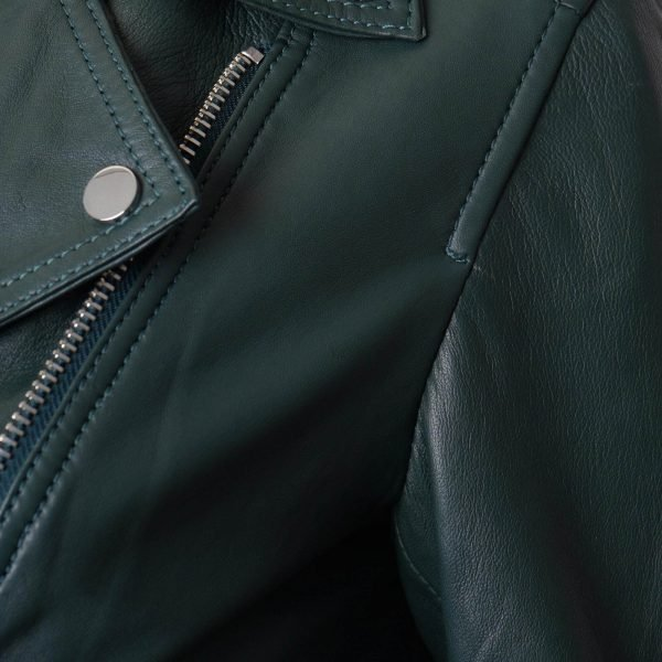 Image displays a close up shot of the green leather jacket to expose the silver trimmings and add more detail.