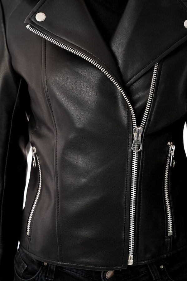 The image displays a close up of the faux leather biker jacket for you to see the smooth texture of the material. The image also zooms in on the silver coloured trims.