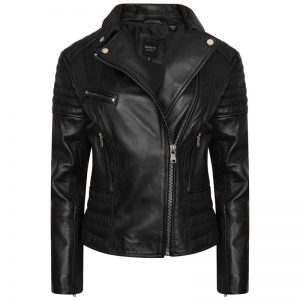 Image displays a leather jacket called the Annie by Barneys Originals. The Jacket is black with silver hardware. It has one main asymmetric zipline and three zip pockets. The jacket is half zipped up to show the lapels open. There are silver pop studs on the corners of the lapels.
