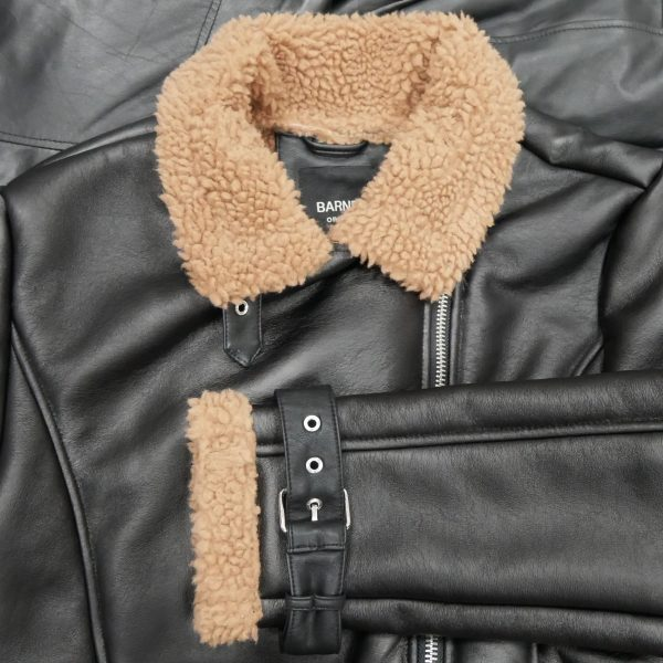 Image displays a close up flat lay of the faux shearling jacket from Barneys Originals.