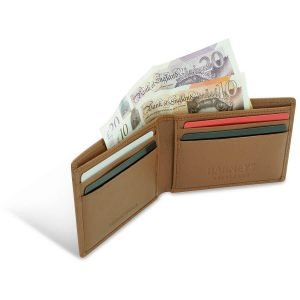 Image displays an open wallet. The wallet is made from goat leather and has 4 card slots for credit cards and loyalty cards. The wallet is stuffed with bank notes to show that UK notes fit perfectly in the wallet.