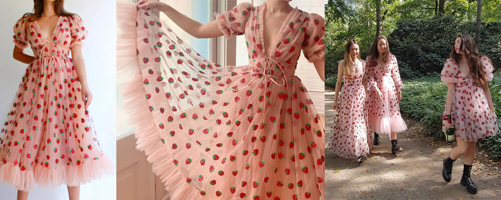Image displays 5 different stylings of the iconic strawberry dress. It is a pink tulle dress with glittery strawberries all over it.
