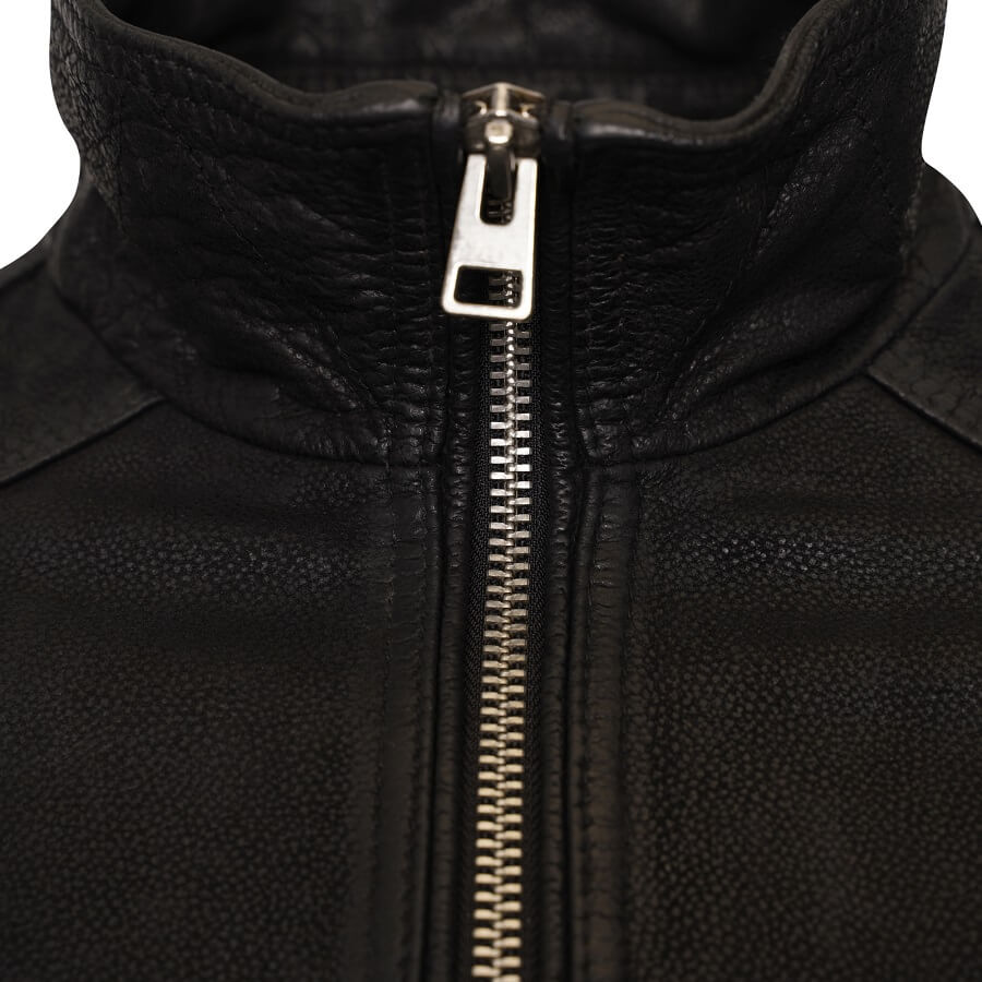 Image displays the neckline of the Barneys Originals leather jacket.