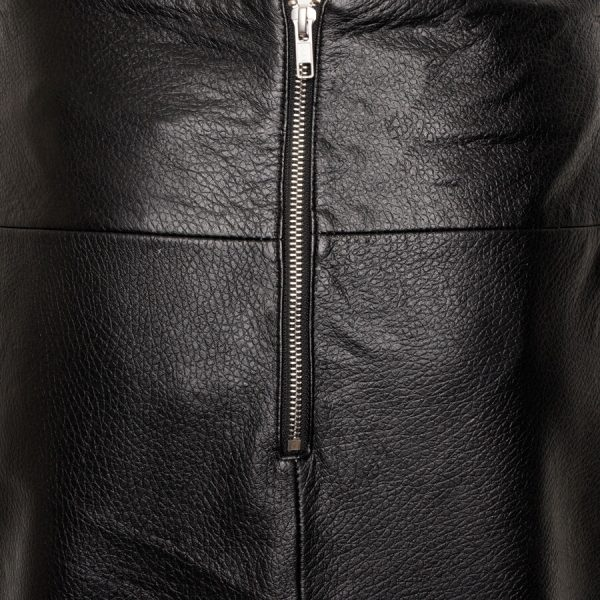 Image displays a close up shot of the leather used on the mini skirt. It has a grainy texture and some wrinkled detailing.